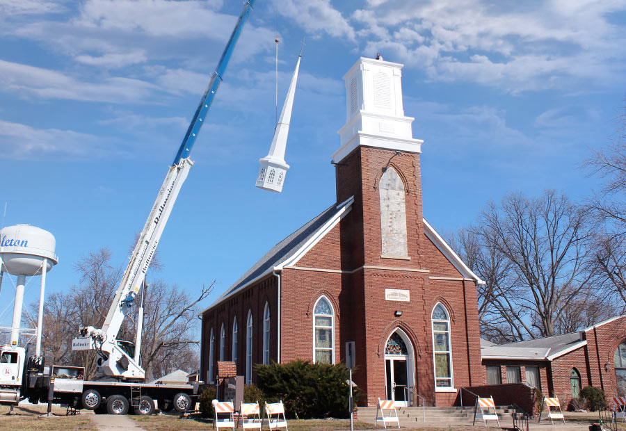Steeple top being placed on Hoyleton Zion Evangelical United Church Of Christ in Mt. Vernon, Illinois