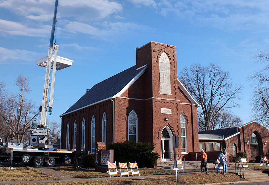 Steeple base being placed on Hoyleton Zion Evangelical United Church Of Christ in Mt. Vernon, Illinois